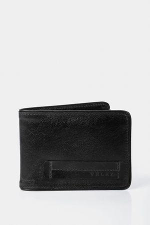 Billetera de cuero sobrepuesto